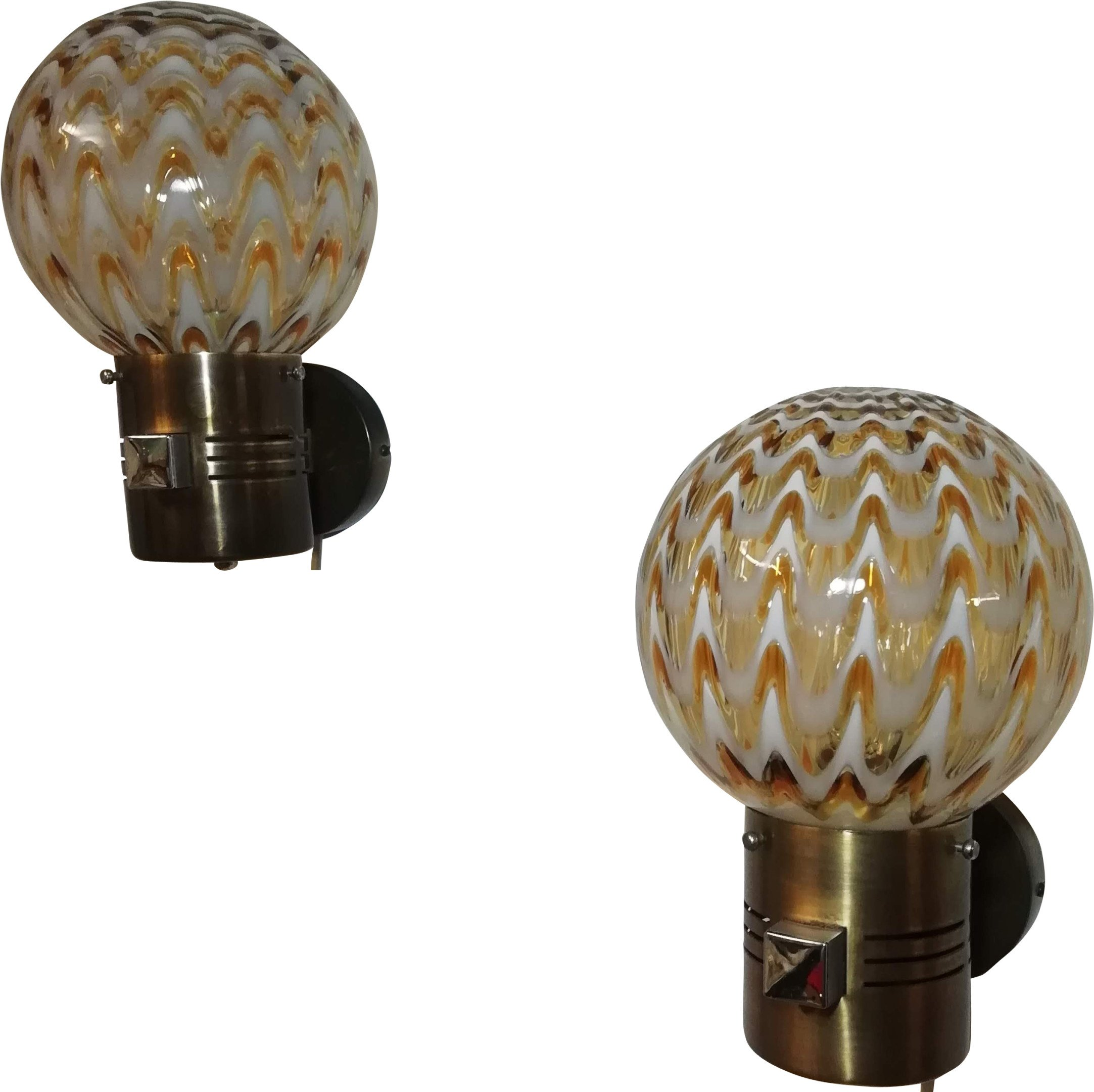Paire of Murano glass wallsconces from Italy. 70s.